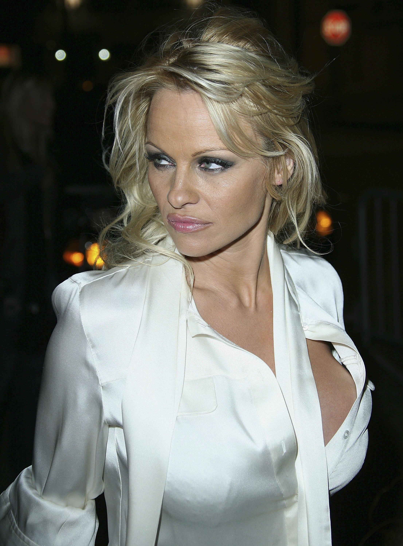 49852_celeb_city.eu_Pamela_Anderson_Playboy_Legacy_Collection_Launch_06_123_483lo.jpg