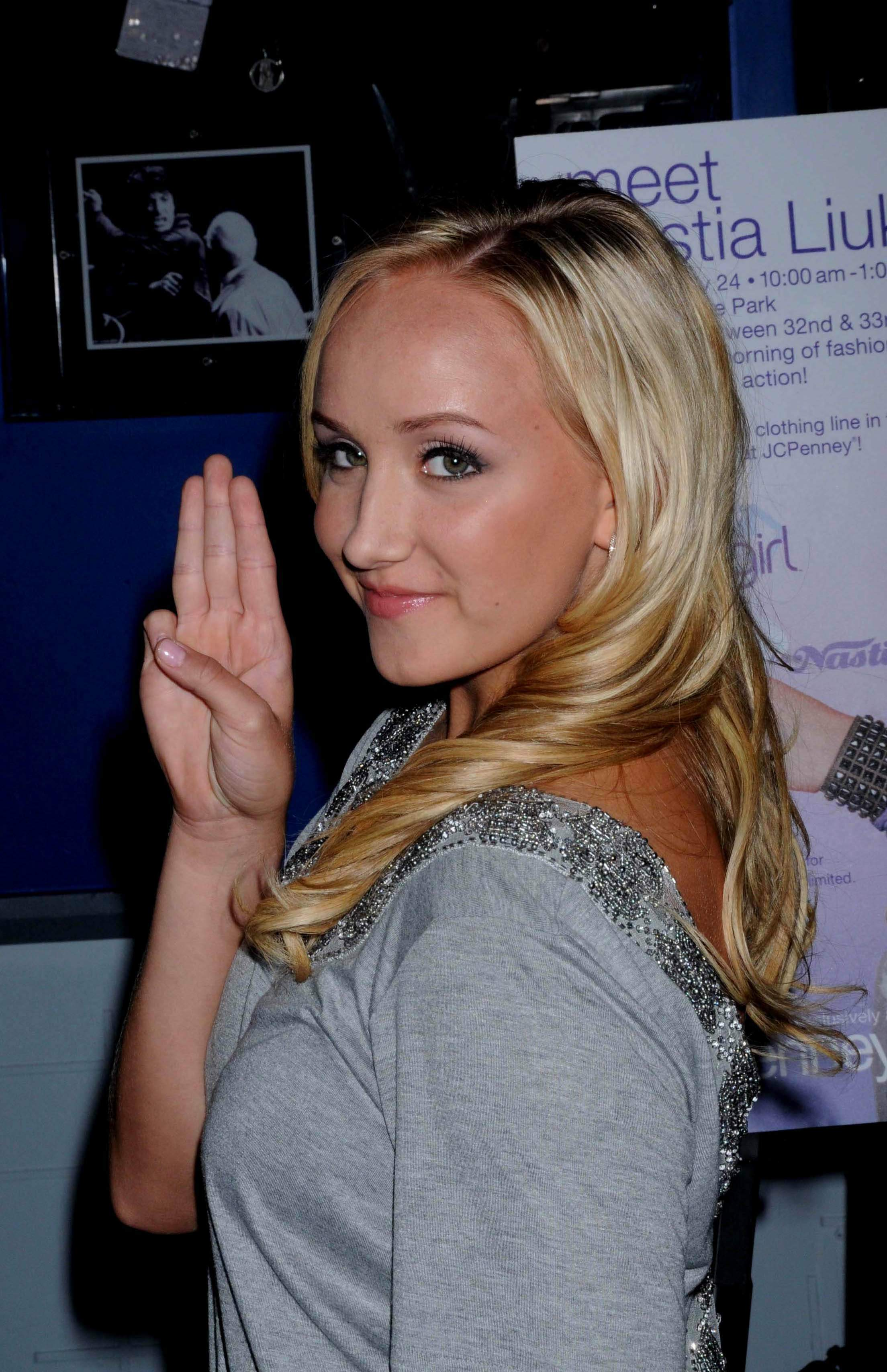 116971284_Nastia_liukin_promotes_Supergirl_clothing_line_at_Planet_Hollywood_1_122_587lo.jpg