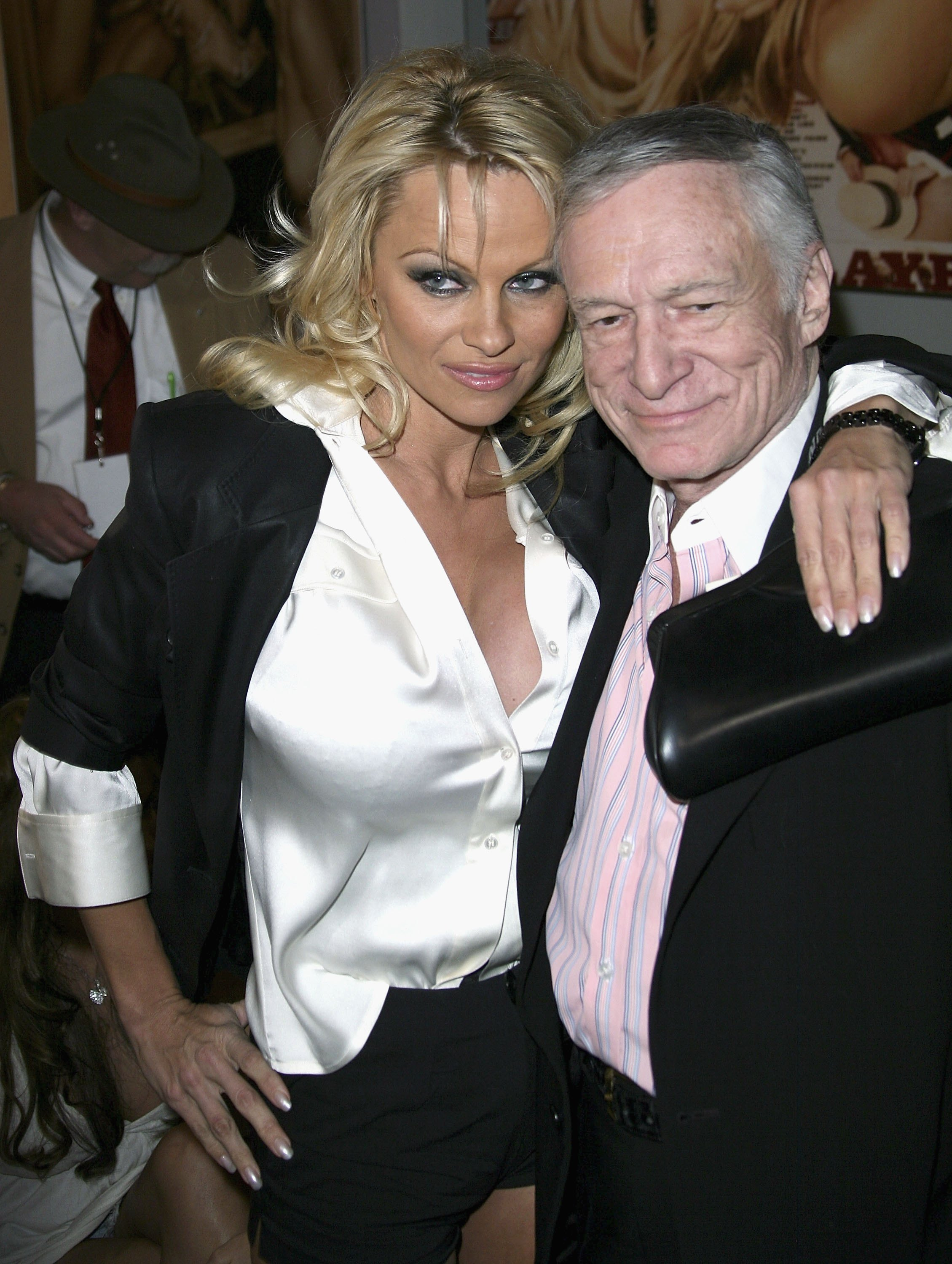 49791_celeb_city.eu_Pamela_Anderson_Playboy_Legacy_Collection_Launch_03_123_572lo.jpg