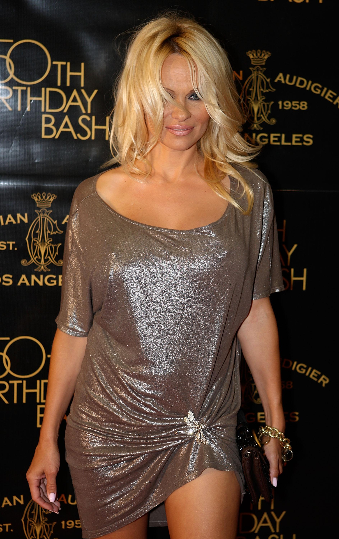 49185_Celebutopia-Pamela_Anderson-Designer_Christian_Audigier1s_50th_Birthday_Bash-01_122_636lo.jpg