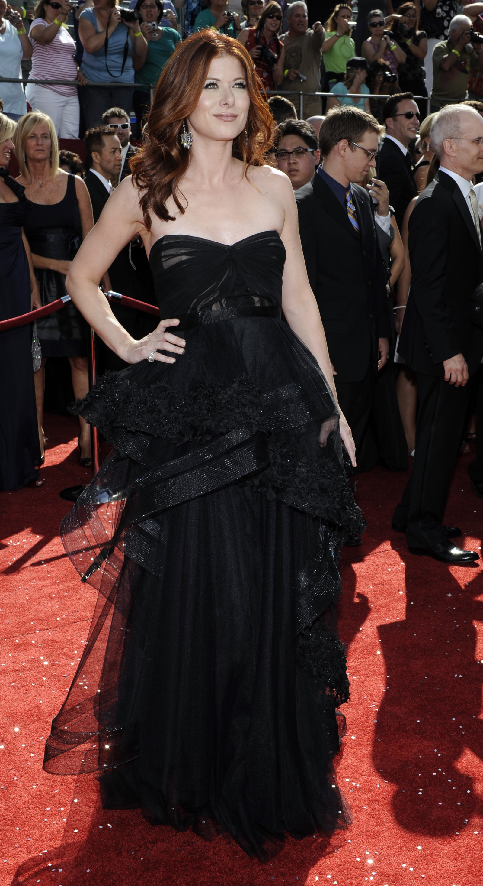 37401_Celebutopia-Debra_Messing_arrives_at_the_60th_Annual_Primetime_Emmy_Awards-01_122_822lo.jpg
