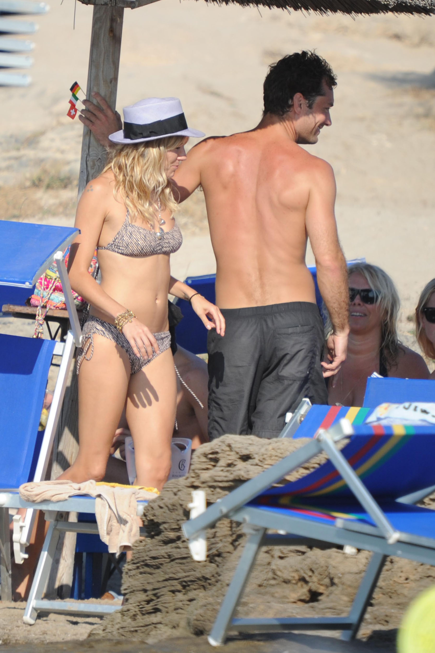 87900_Sienna_Miller_Bikini_Italy_122_405lo.jpg