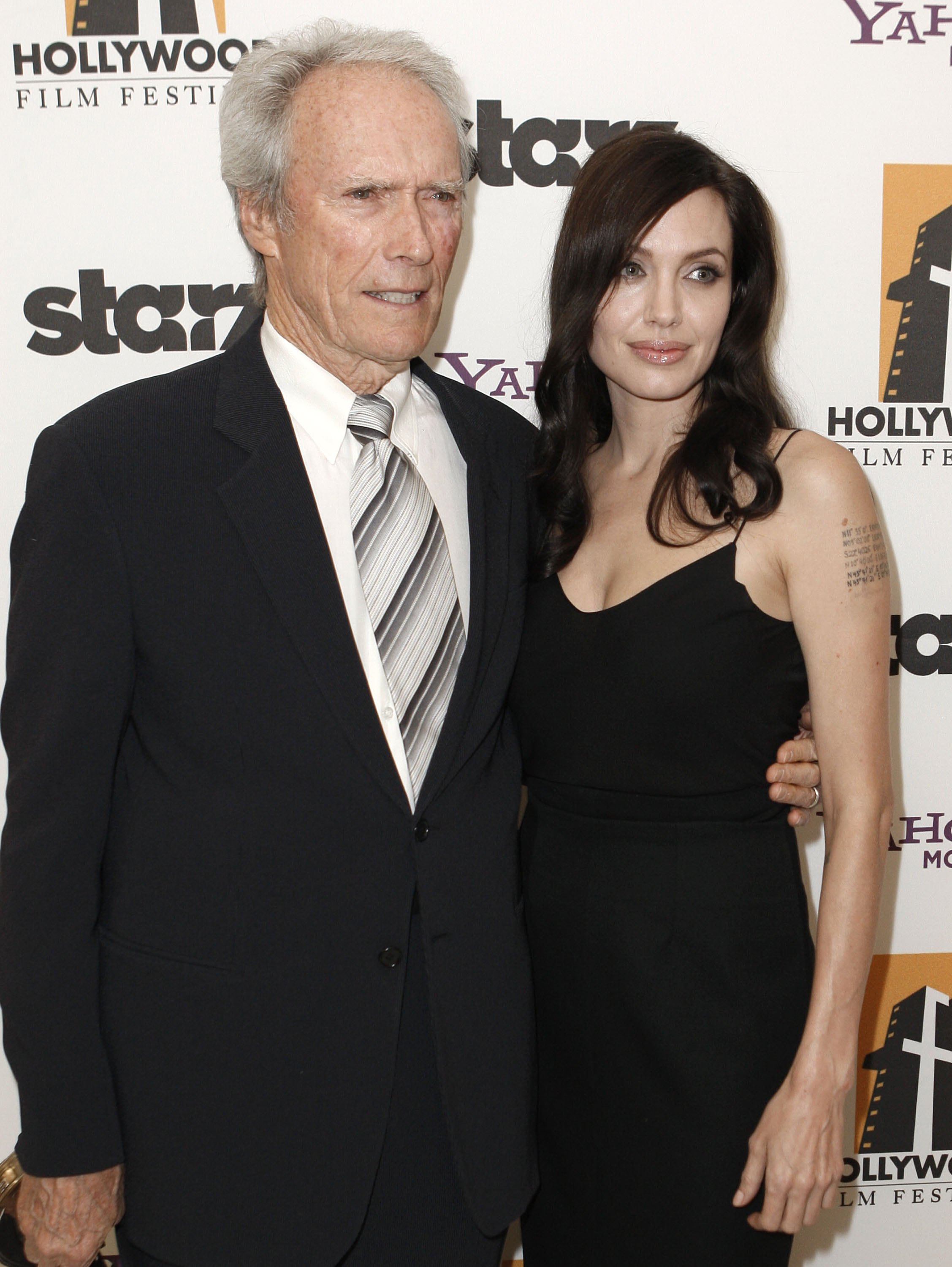 70203_Angelina_Jolie_and_Clint_Eastwood_-_backstage_at_the_Hollywood_Awards_Gala_CU_ISA_004_122_1077lo.jpg