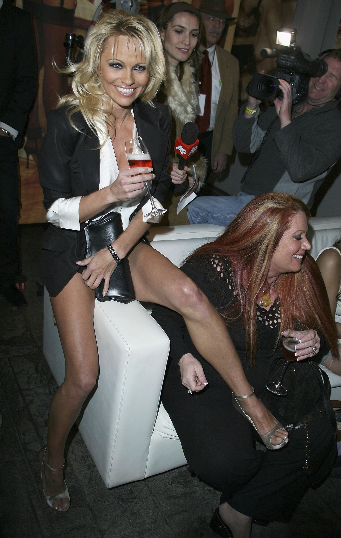 49929_celeb_city.eu_Pamela_Anderson_Playboy_Legacy_Collection_Launch_07_123_555lo.jpg