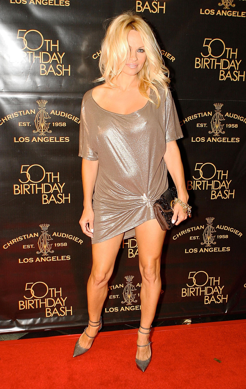 48837_Celebutopia-Pamela_Anderson-Designer_Christian_Audigier76s_50th_Birthday_Bash-02_122_918lo.jpg
