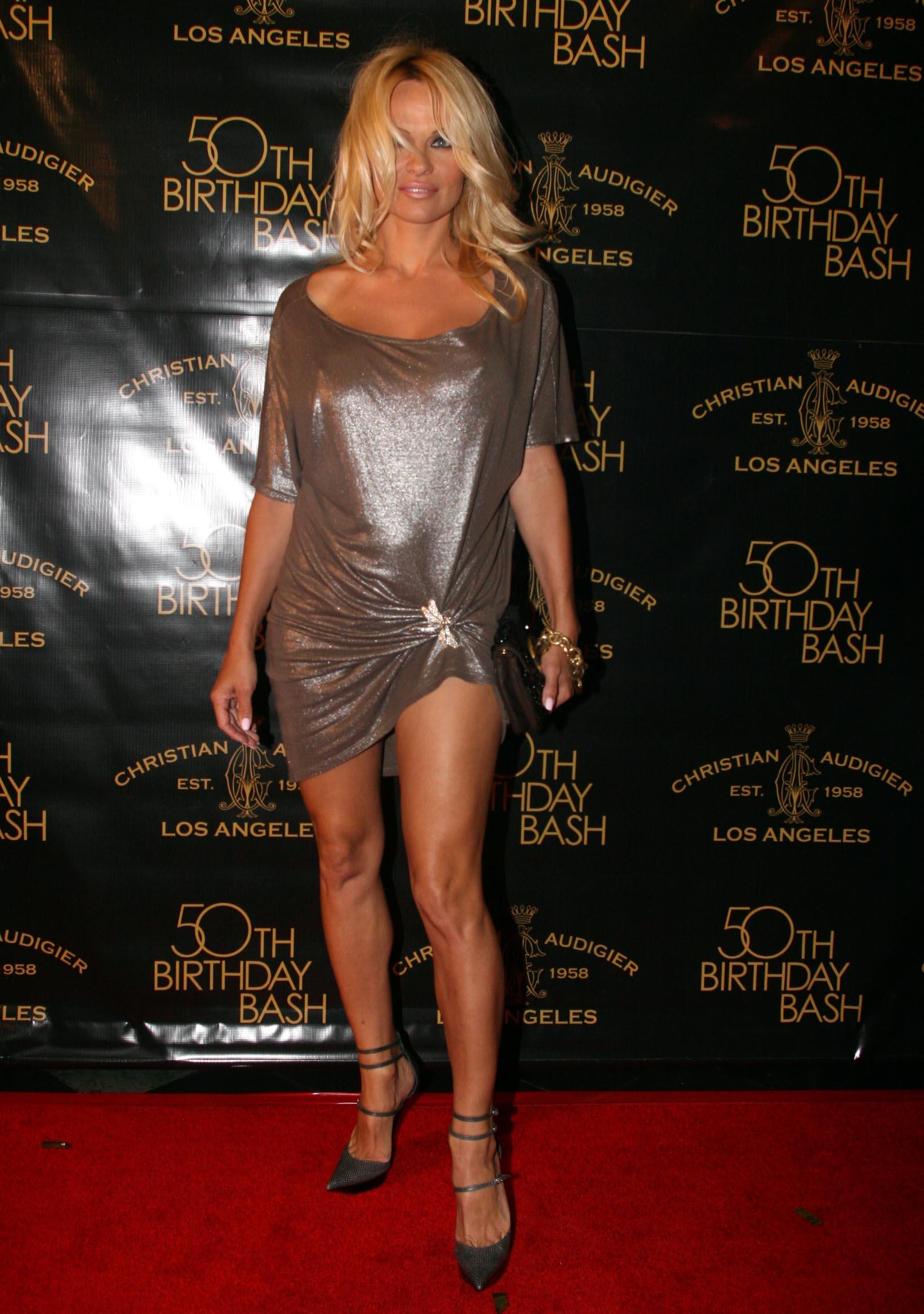 49089_Celebutopia-Pamela_Anderson-Designer_Christian_Audigier6s_50th_Birthday_Bash-05_122_923lo.jpg