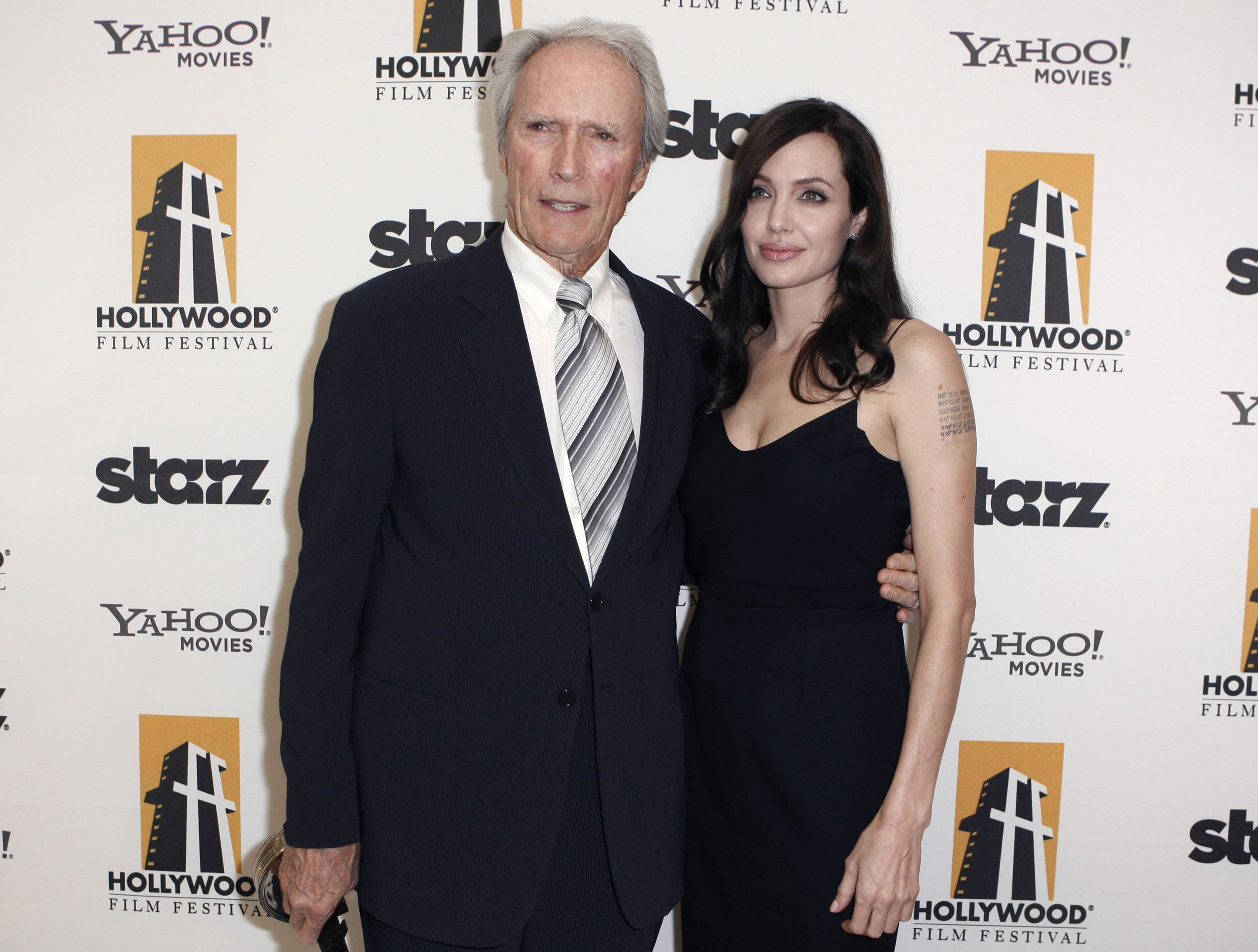69969_Angelina_Jolie_and_Clint_Eastwood_-_backstage_at_the_Hollywood_Awards_Gala_CU_ISA_003_122_527lo.jpg