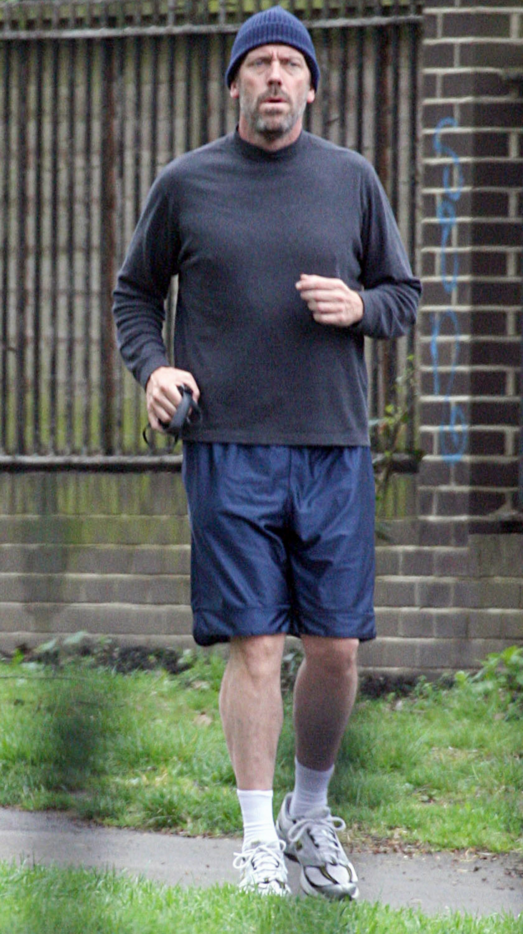 64050_Hugh_Laurie_jogging_in_London_with_his_dog2_April19-05_122_1140lo.jpg