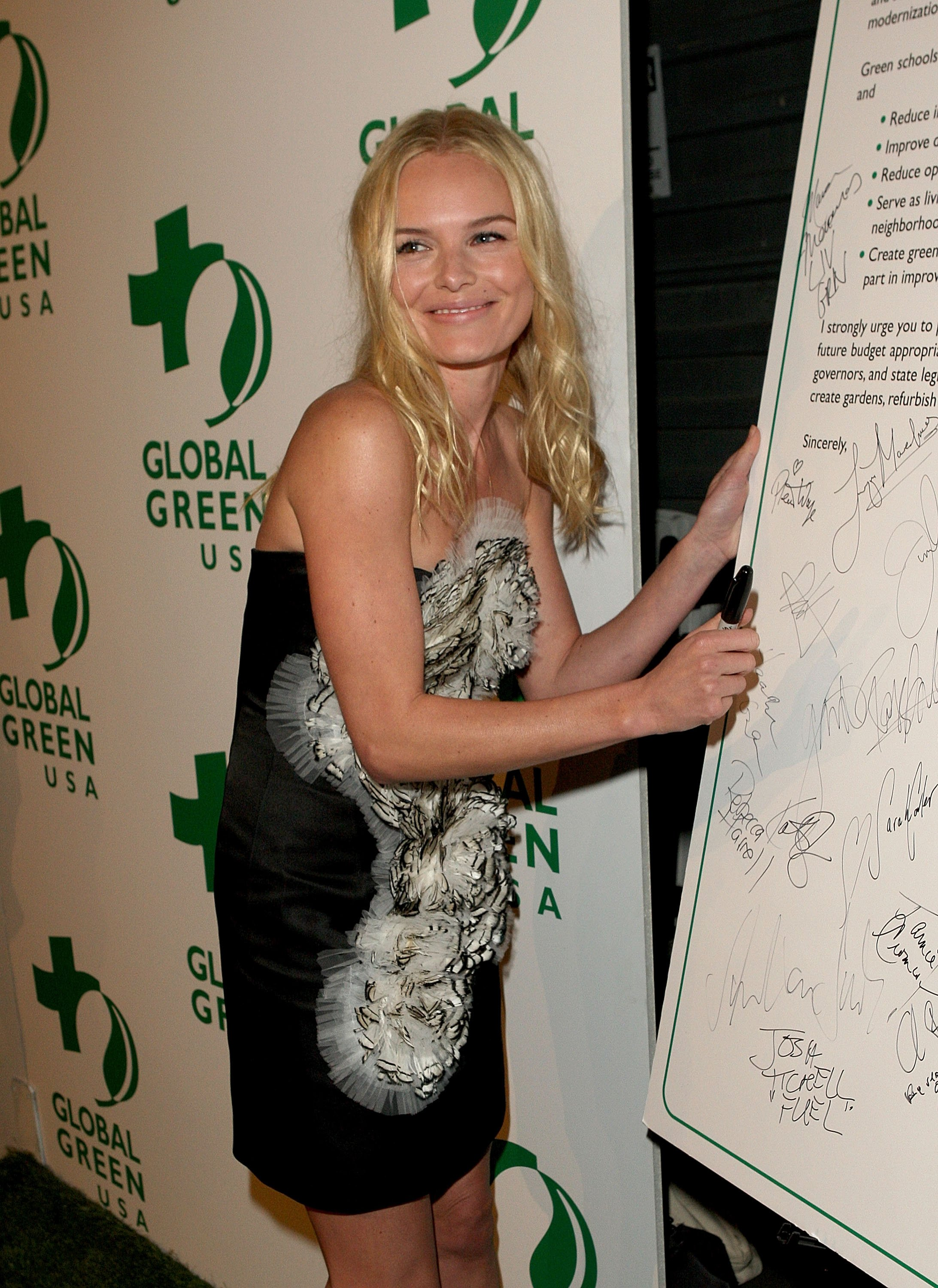 13018_Celebutopia-Kate_Bosworth_arrives_at_Global_Green_USA97s_6th_Annual_Pre-Oscar_Party-09_122_228lo.jpg