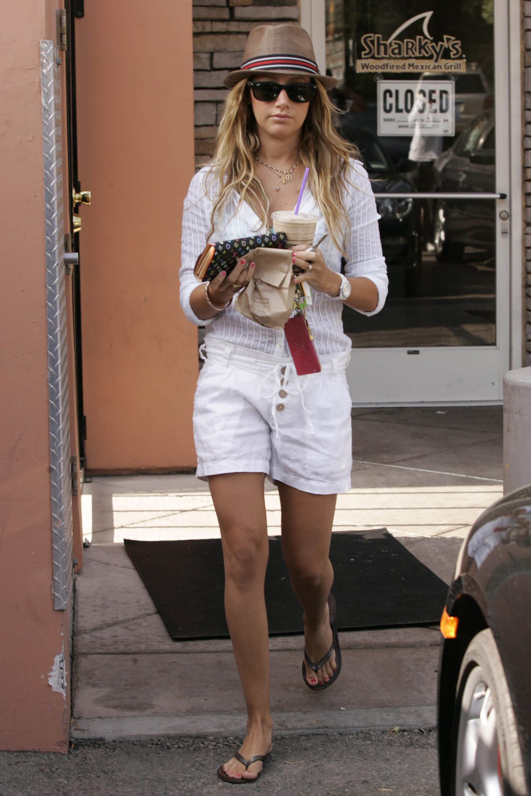 90357_Ashley_Tisdale_leaving_Coffee_Bean_in_Los_Angeles_290708_08_123_16lo.jpg