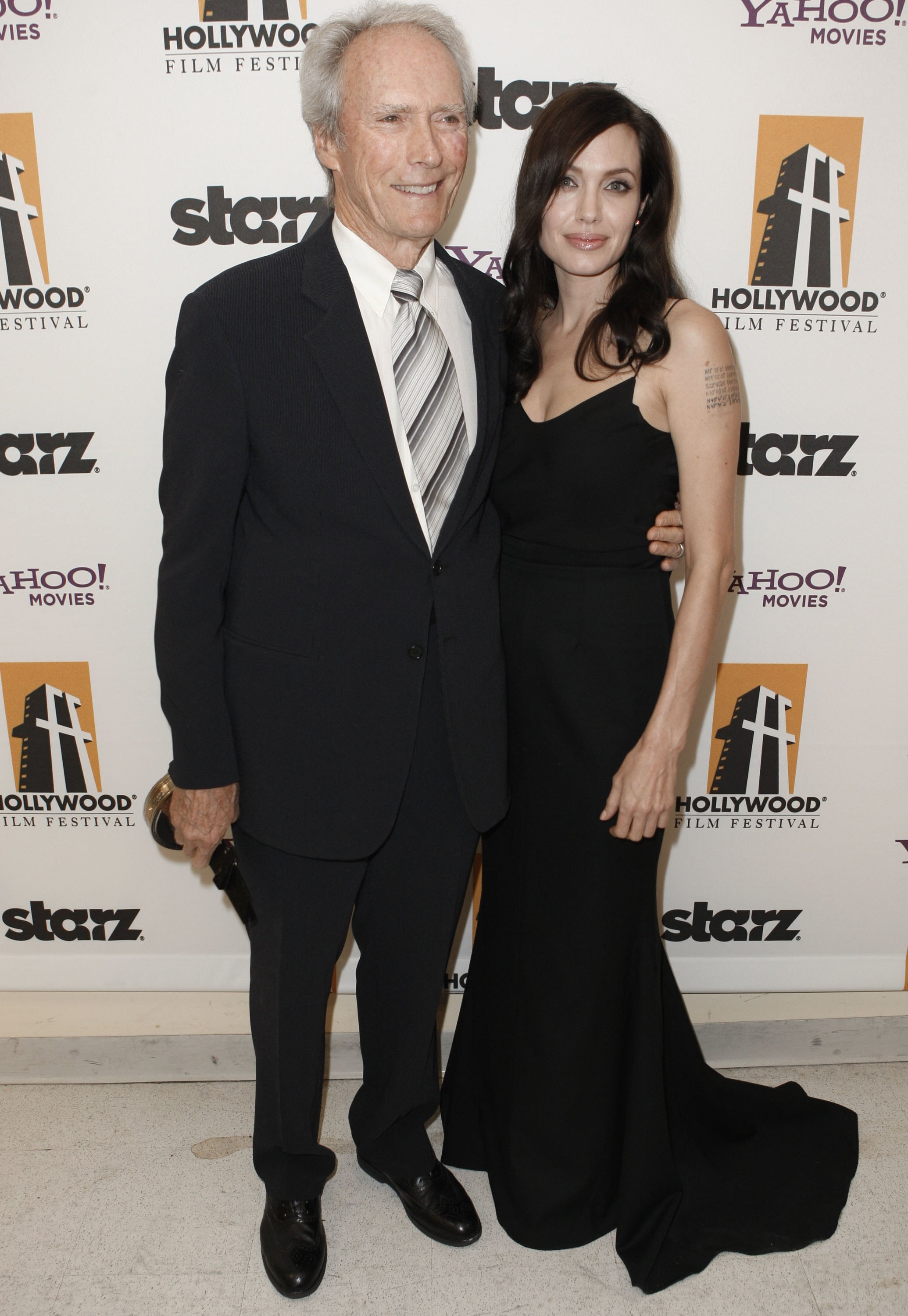 70189_Angelina_Jolie_and_Clint_Eastwood_-_backstage_at_the_Hollywood_Awards_Gala_CU_ISA_002_122_539lo.jpg