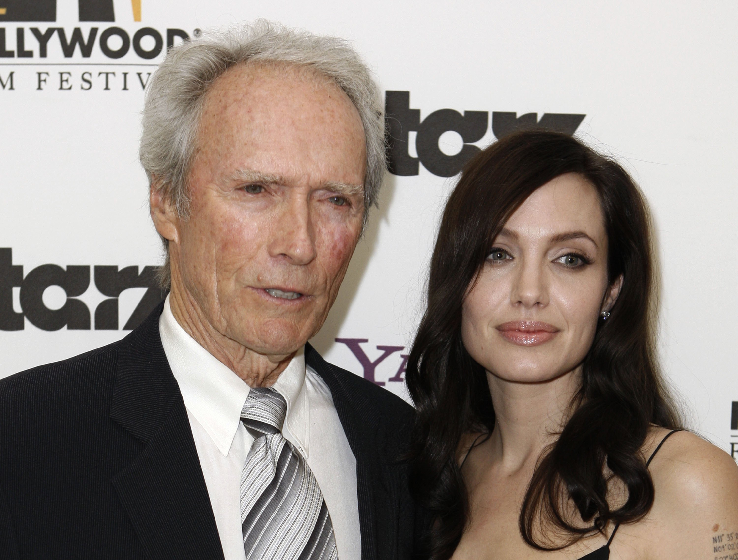 69918_Angelina_Jolie_and_Clint_Eastwood_-_backstage_at_the_Hollywood_Awards_Gala_CU_ISA_001_122_234lo.jpg