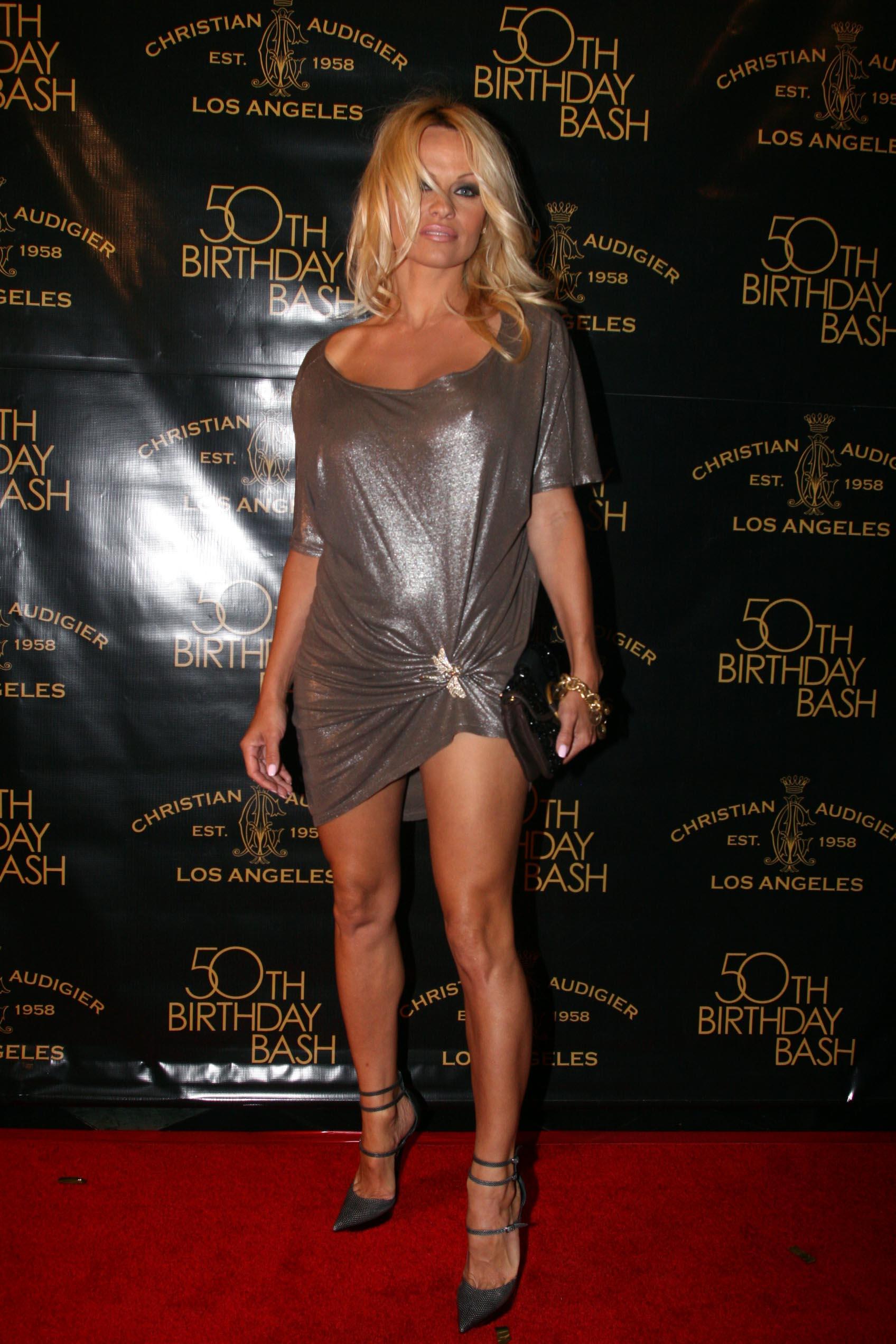 48913_Celebutopia-Pamela_Anderson-Designer_Christian_Audigier58s_50th_Birthday_Bash-03_122_512lo.jpg