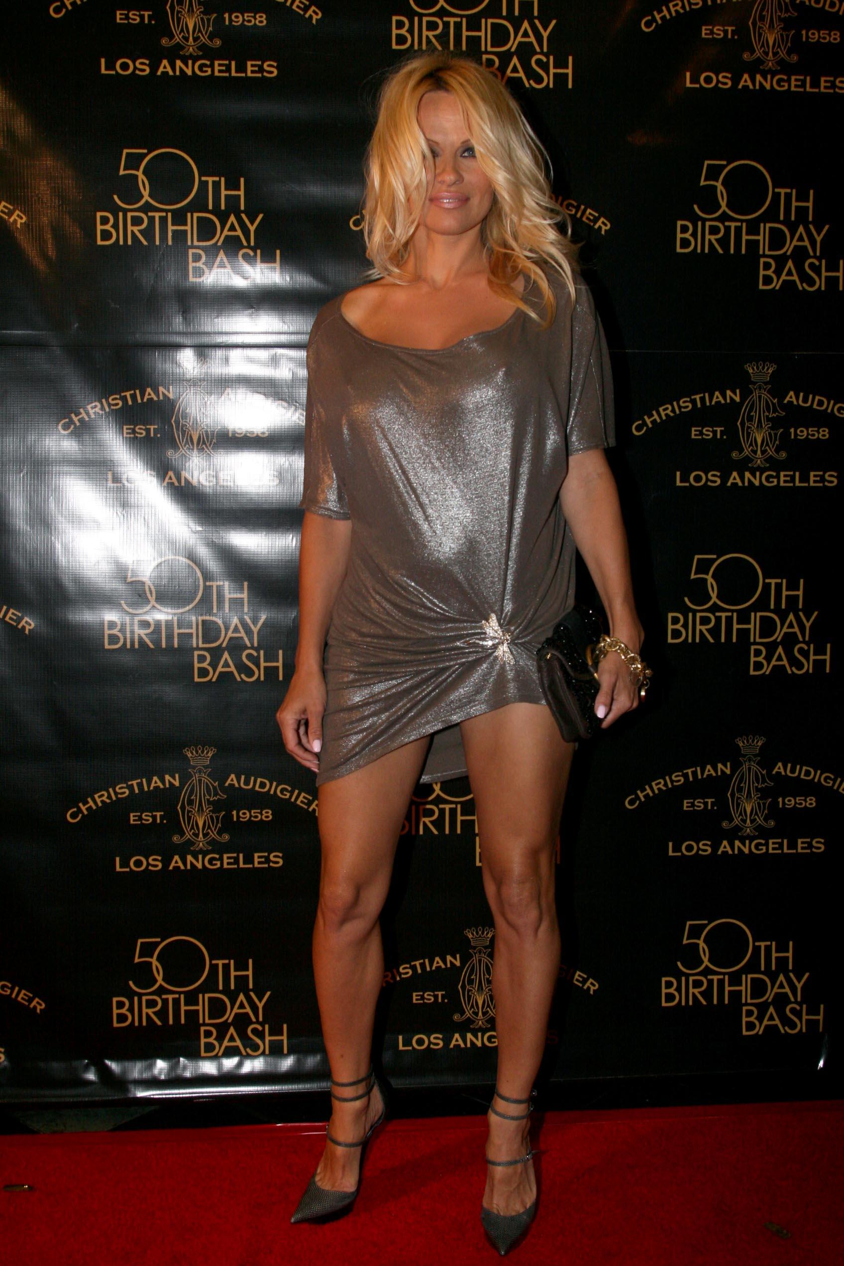 49207_Celebutopia-Pamela_Anderson-Designer_Christian_Audigier84s_50th_Birthday_Bash-07_122_518lo.jpg